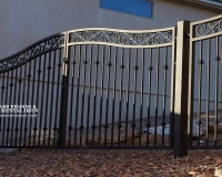 iron gate with forged scrolls