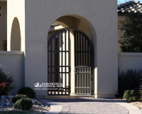 contemporary arched security courtyard gate