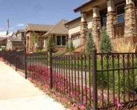 Ornamental fence with C scrolls
