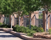 curved fence with cast scrolls